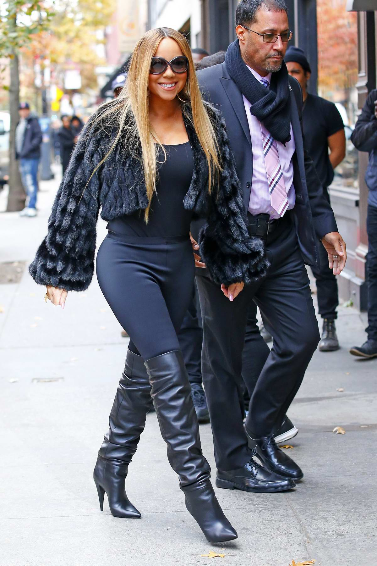 Mariah Carey wears black fur coat, black leggings with a pair of knee high boots while out in New York City