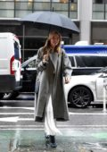 Martha Hunt seen wearing a long white dress with a trench coat as she arrives for the fittings at Victoria's Secret offices in New York City