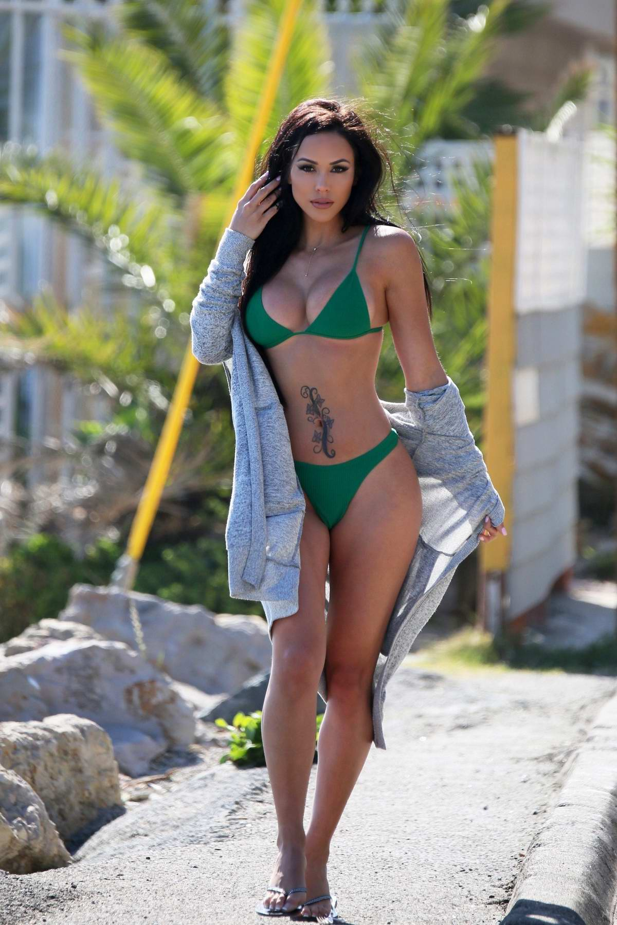 Melissa Riso seen wearing a green bikini during an editorial photoshoot for 138 Water in Malibu, California