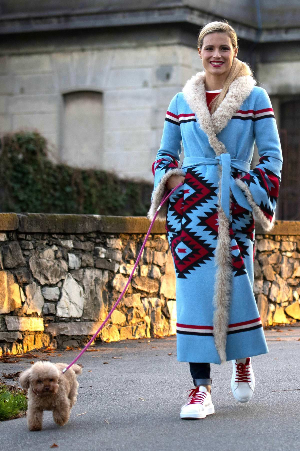 Michelle Hunziker takes her daughter Sole to the park with their dog in Milan, Italy