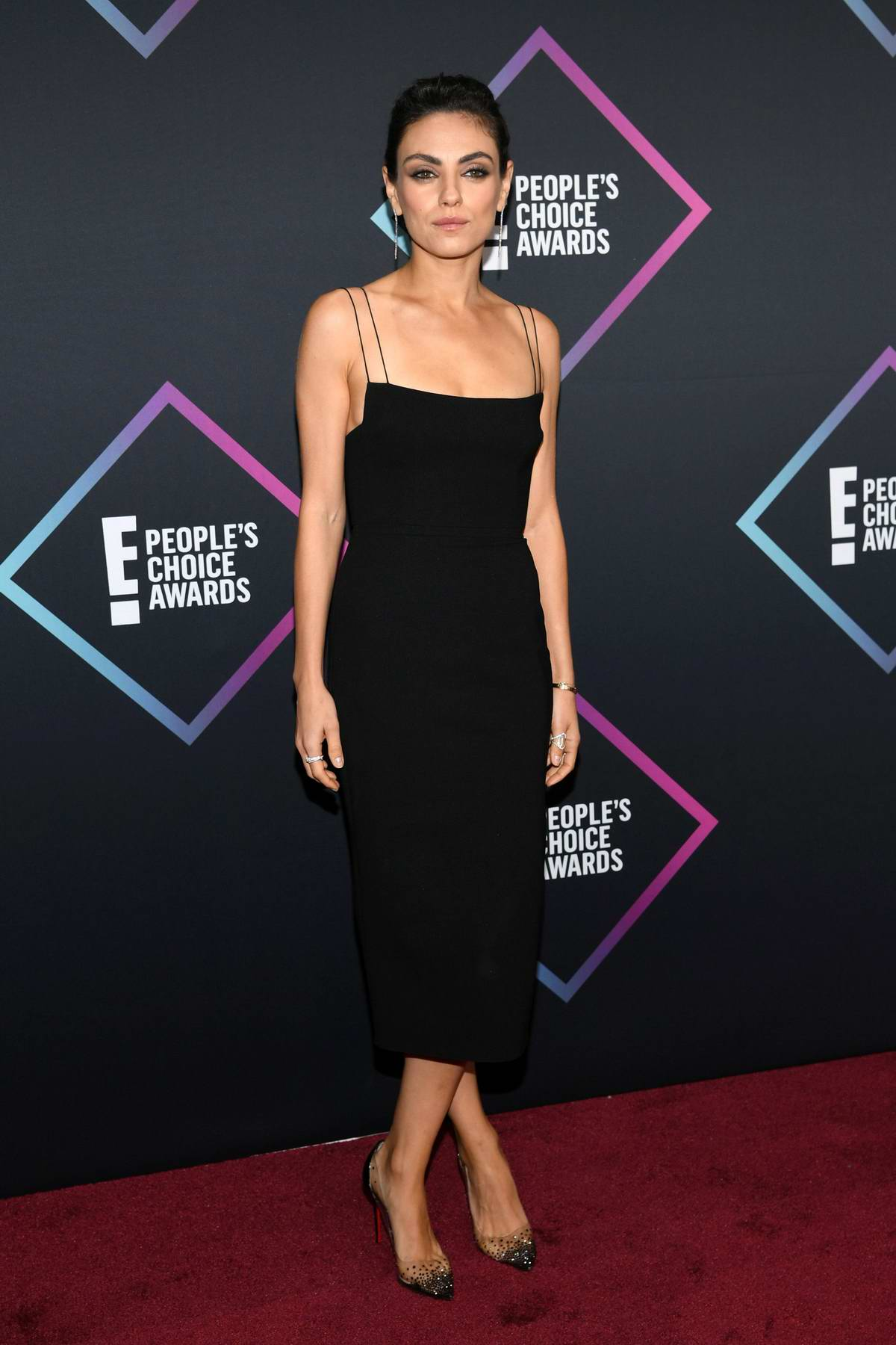Mila Kunis attends People's Choice Awards 2018 at Barker Hangar in Santa Monica, California