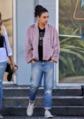 Mila Kunis keeps it casual with a purple fleece, ripped jeans and converse as she stops by Von's Market with a friend in Studio City, Los Angeles