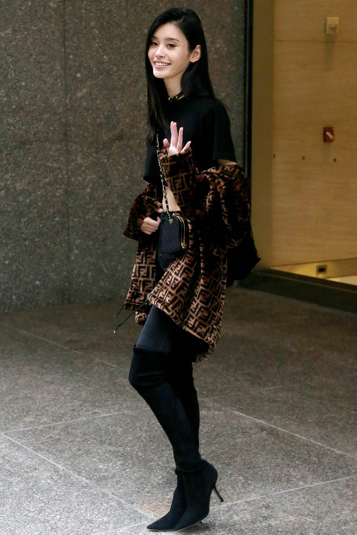 Ming Xi rocks all black with a Fendi trench coat while visiting Victoria's Secret offices in New York City