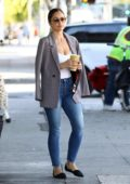 Minka Kelly looks stylish in a blazer paired with white top and jeans while picking up a healthy smoothie in Los Angeles