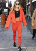 Nina Agdal looks striking in orange as she steps out for lunch with boyfriend Jack Brinkley-Cook in New York City