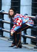 Nina Dobrev seen wearing a colorful patterned sweater on the set of a photoshoot in SoHo, New York City