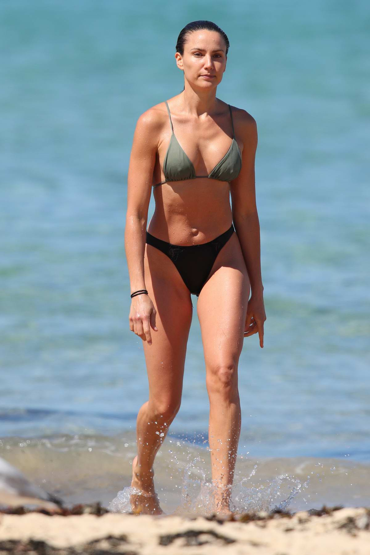 Rachael Finch spotted in a bikini as she takes a dip in the ocean at North Bondi beach in Sydney, Australia