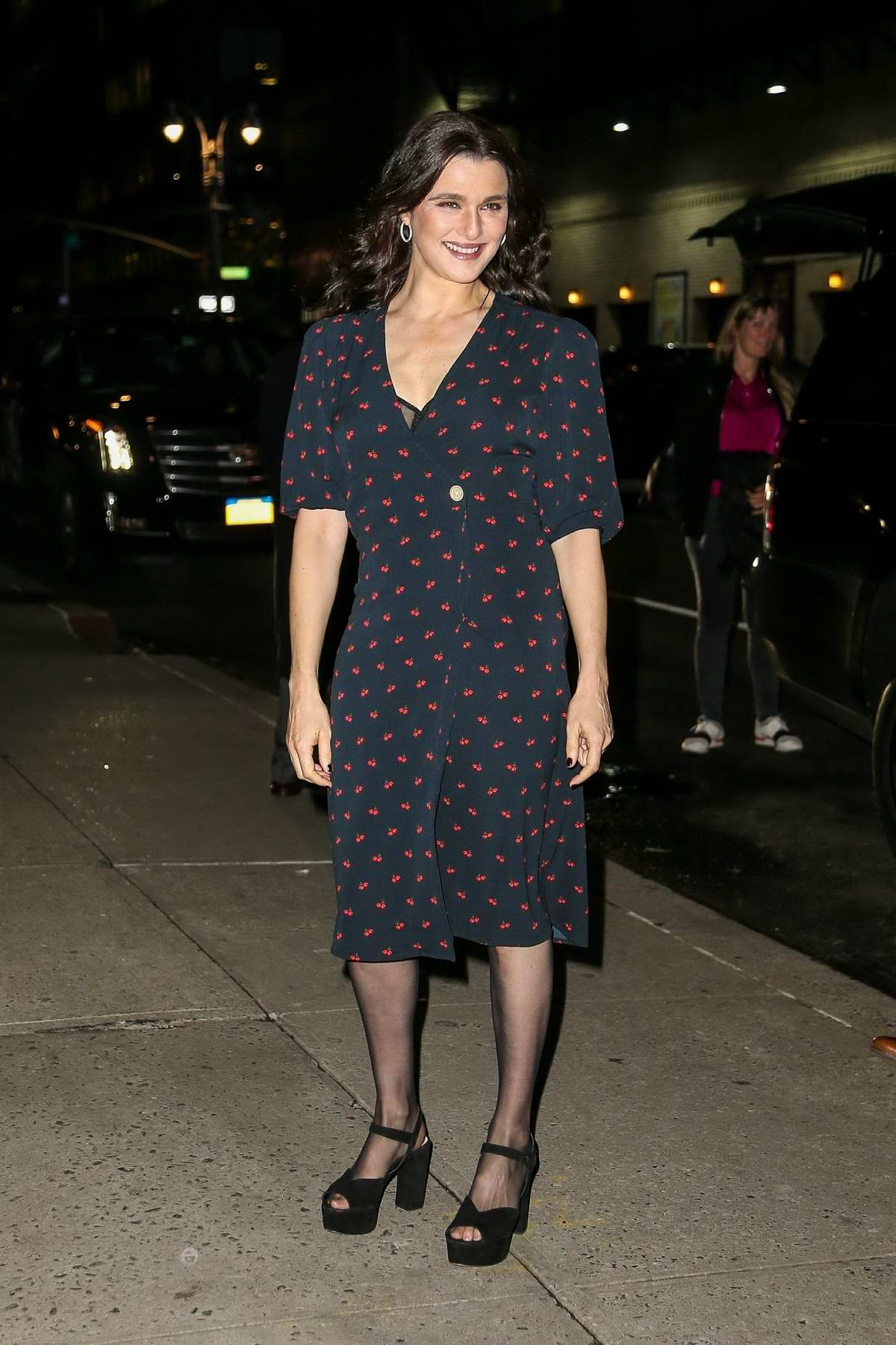 Rachel Weisz wears a red cherry-print dress as she arrives for her appearance on 'The Late Show With Stephen Colbert' in New York City