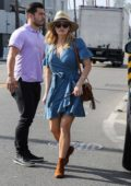 Reese Witherspoon wears a denim dress as she and Jim Toth grabs an early dinner at Gjelina in Venice, Los Angeles
