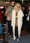 Rita Ora keeps it casual yet stylish as she touches down at Sydney airport, Australia