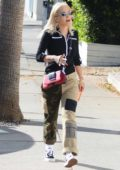 Rita Ora wore a black shirt and camo pants while out shopping for furniture with a male friend in West Hollywood, Los Angeles
