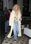 Rita Ora wore a white fuzzy coat over a ruffled shirt and jeans during a night out at Electric Cinema in Notting Hill, London