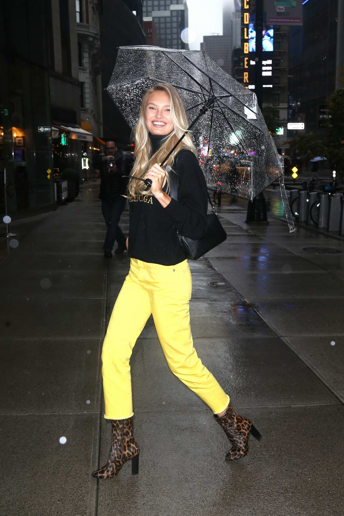 Romee Strijd stands out in bright yellow jeans and Balenciaga turtleneck paired with leopard print boots as she visits Victoria's Secret offices in New York City