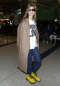 Rosamund Pike keeps it casual in t-shirt and jeans as she arrives at LAX airport in Los Angeles