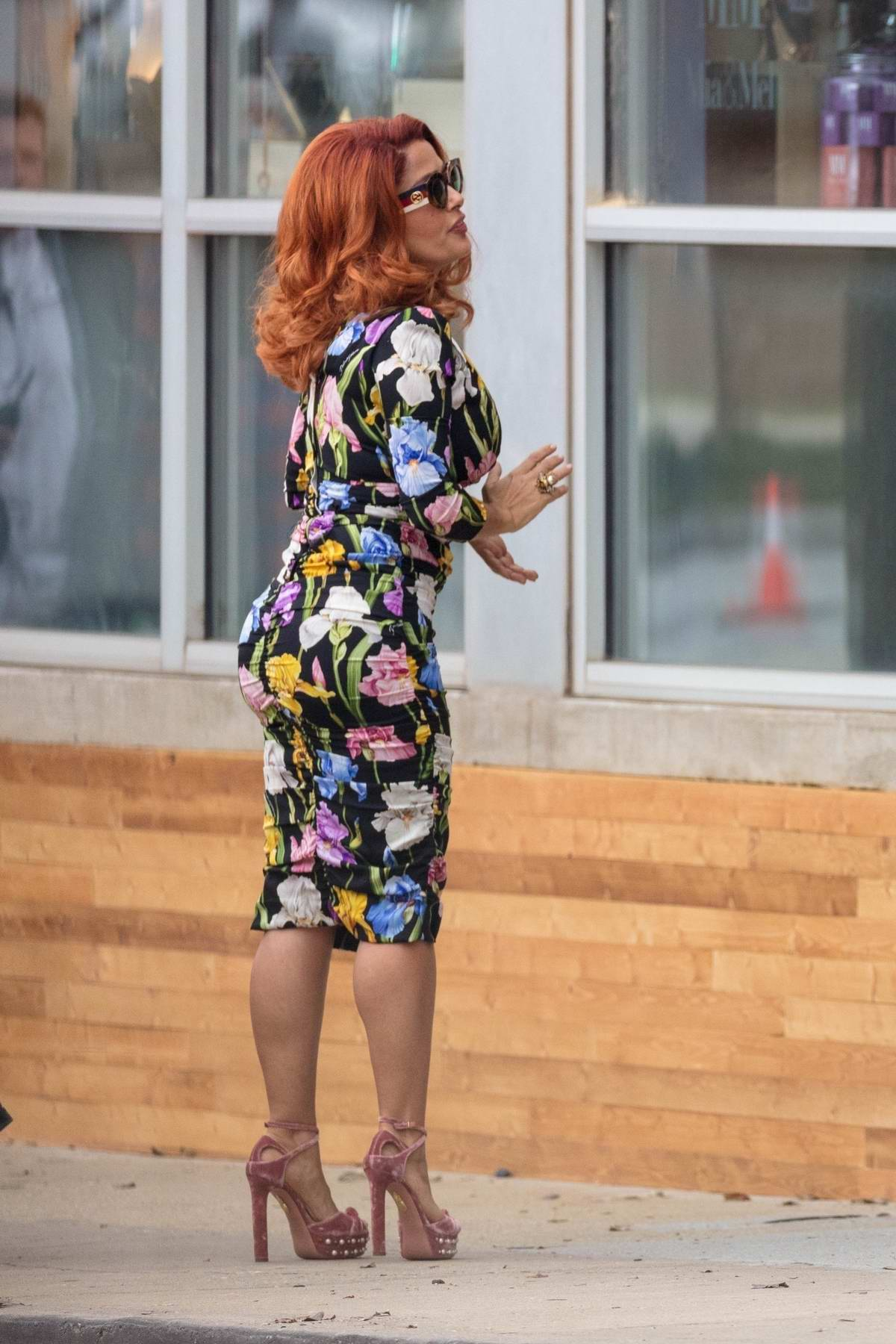 Salma Hayek spotted in a redhead look while wearing a floral dress on the set of 'Limited Partners' in Atlanta, Georgia