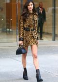 Sara Sampaio poses in a leopard print dress and black boots as she leaves the Victoria's Secret offices in New York City
