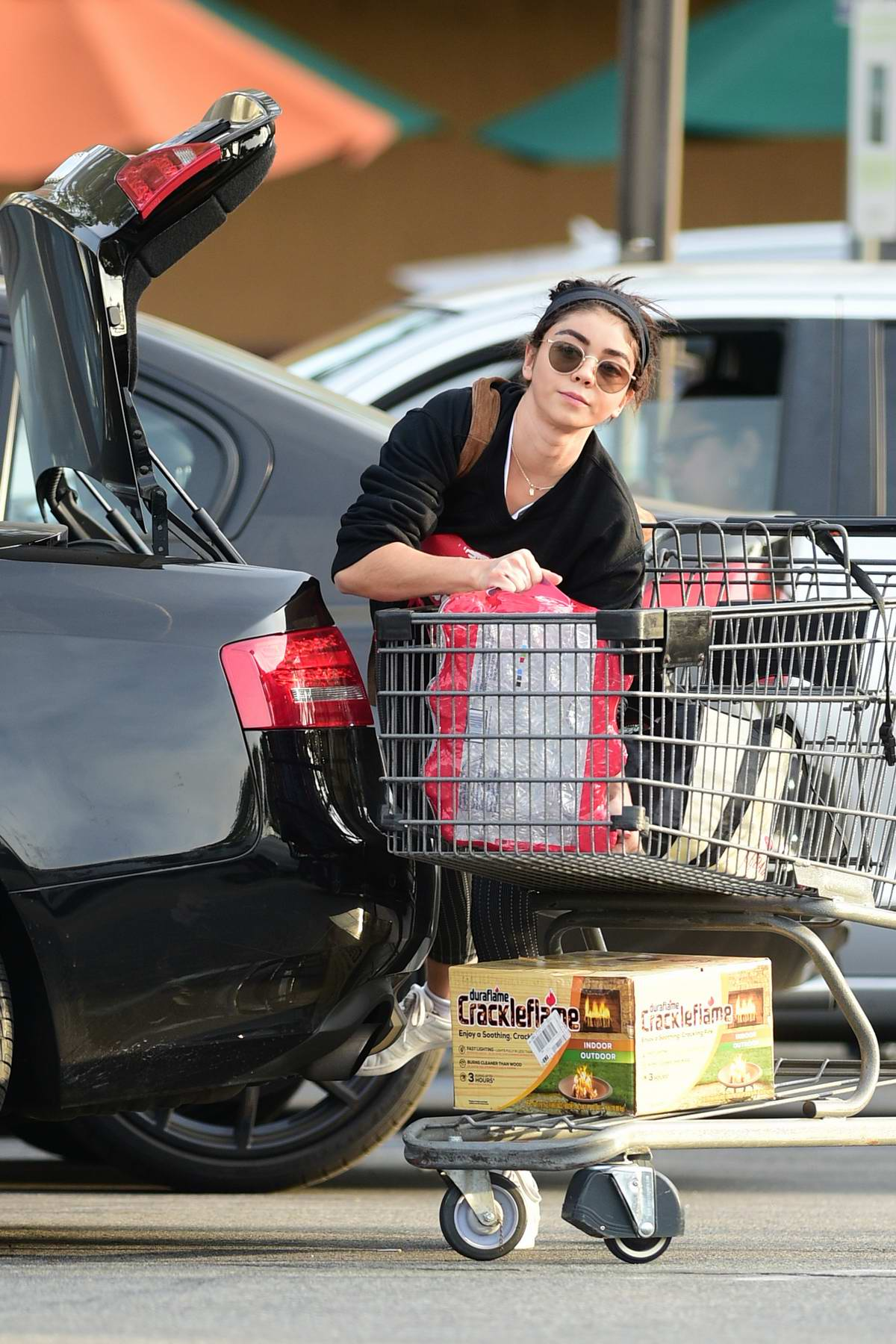Sarah Hyland does some heavy lifting on a grocery shopping trip before thanksgiving in Los Angeles