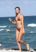 Selena Weber wears a burgundy bikini as she enjoy a beach day with her boyfriend in Miami, Florida