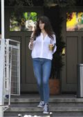 Shailene Woodley steps out in a white shirt and blue jeans to get an Iced Coffee and a Tea in Los Angeles
