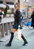 Taylor Hill seen wearing a crop top with a leather jacket and plaid skirt as she leaves Victoria's Secret offices in New York City