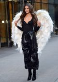 Taylor Hill showcases her Angel Wings while filming a promo event for Victoria's Secret in New York City