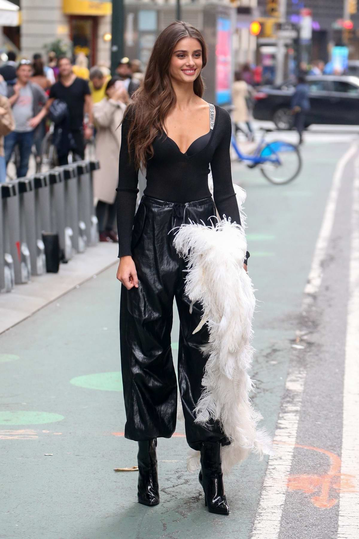 Taylor Hill Showcases Her Angel Wings While Filming Promo