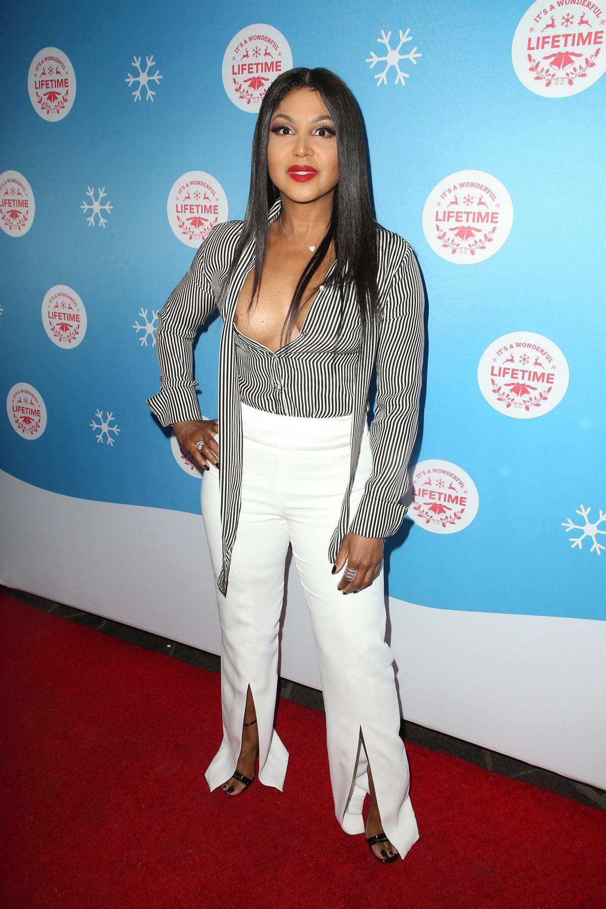 Toni Braxton attends Opening night of Lifetime's life-sized Gingerbread House Experience at The Grove in Los Angeles