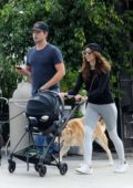 Troian Bellisario and Patrick J. Adams steps out for a stroll with their newborn daughter in Los Angeles