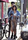 Vanessa Hudgens seen wearing a knotted white top and animal print skirt while out for coffee with Austin Butler in Los Angeles