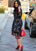 Vicky Pattison wears a patterned blue dress and red pumps with matching red handbag as she leaves ITV Studios in London, UK