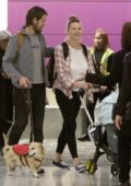 Yvonne Strahovski spotted at the airport with her husband and baby as she lands in Toronto, Canada
