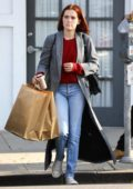 Zoey Deutch seen carrying some shopping bags as she leaves an office building in Los Angeles