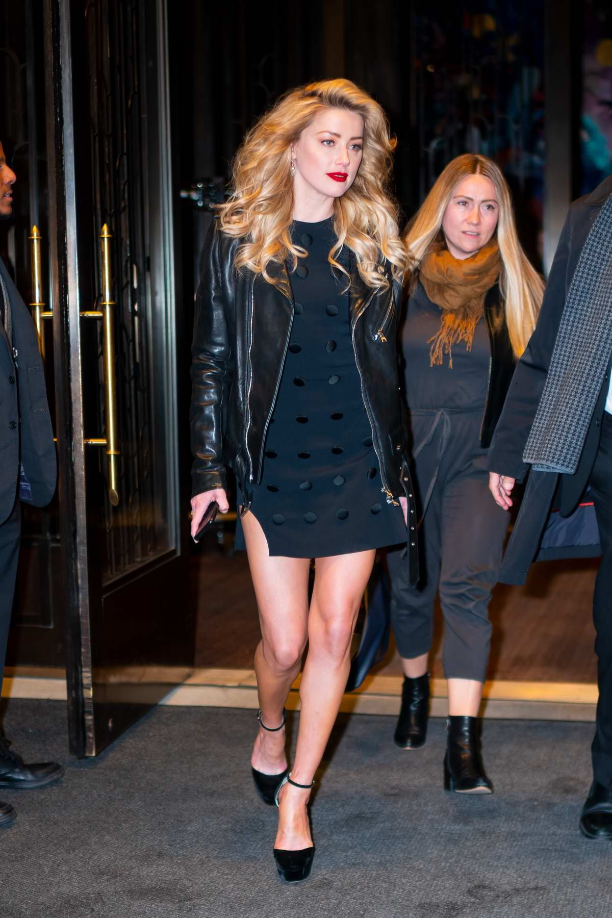 Amber Heard looks stunning in a short black dress and leather jacket as she arrives to the screening of 'Aquaman' in New York City