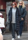 Anne Hathaway hide behind dark sunglasses on her way to set to film 'Modern Love' in New York City