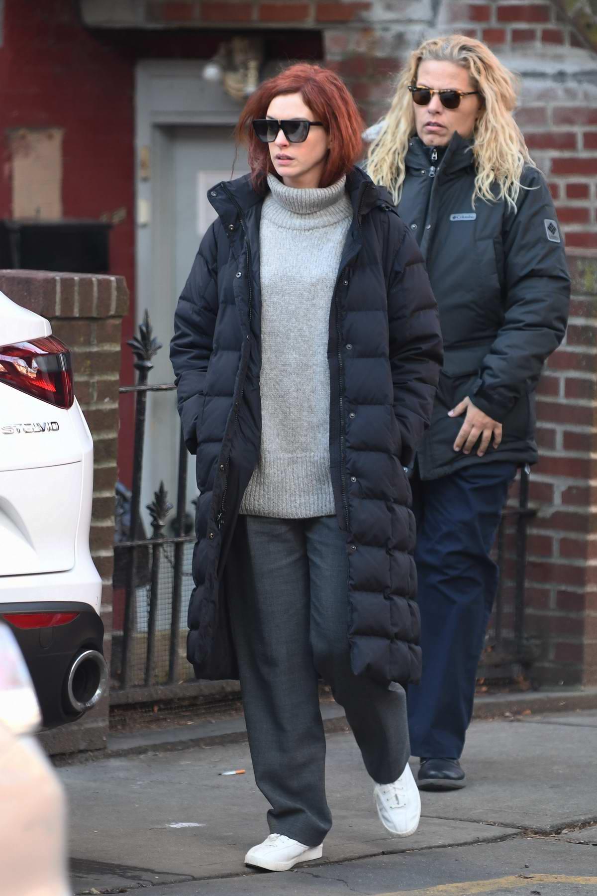 Anne Hathaway hide behind dark sunglasses on her way to set to film 'Modern Love' in New York City