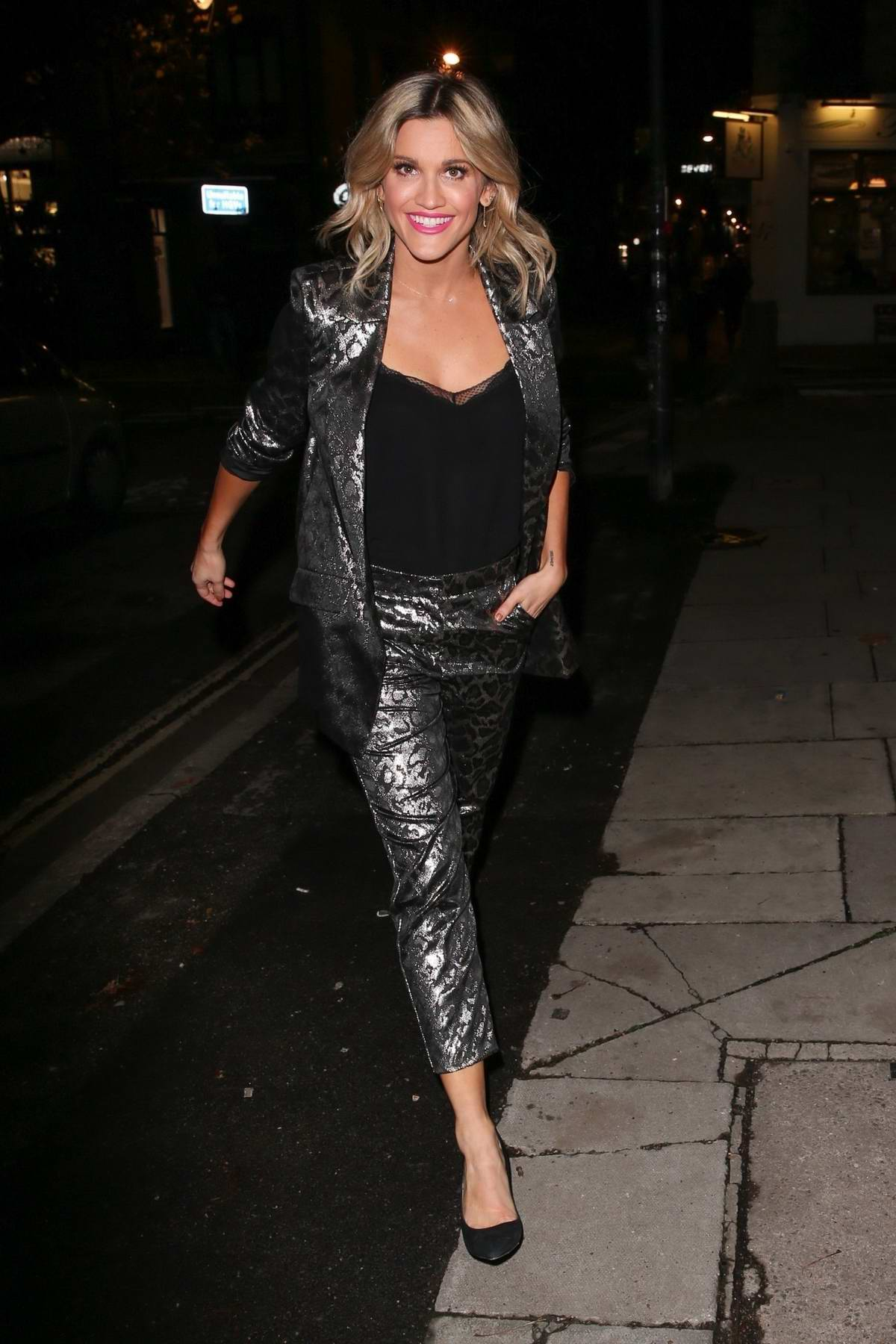 Ashley Roberts is all smiles as she leaves a TV studio in London, UK