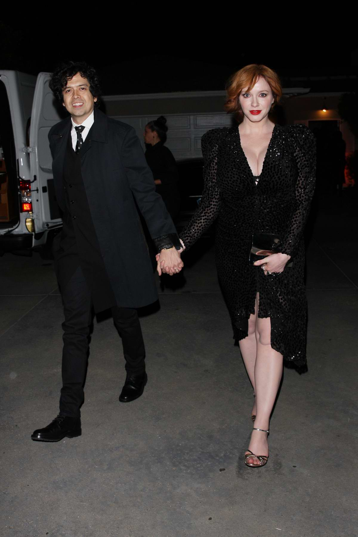 Christina Hendricks and husband Geoffrey Arend arrives at Jennifer Klein's Holiday Party in Los Angeles