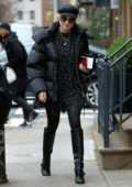 Diane Kruger bundles up in a black puffer jacket and knee high boots as she heads to the U.S. Passport Services Office in New York City
