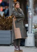 Doutzen Kroes seen wearing green trench coat and platform boots during a photoshoot in New York City