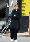 Doutzen Kroes spotted in a black trench coat during a photoshoot in New York City
