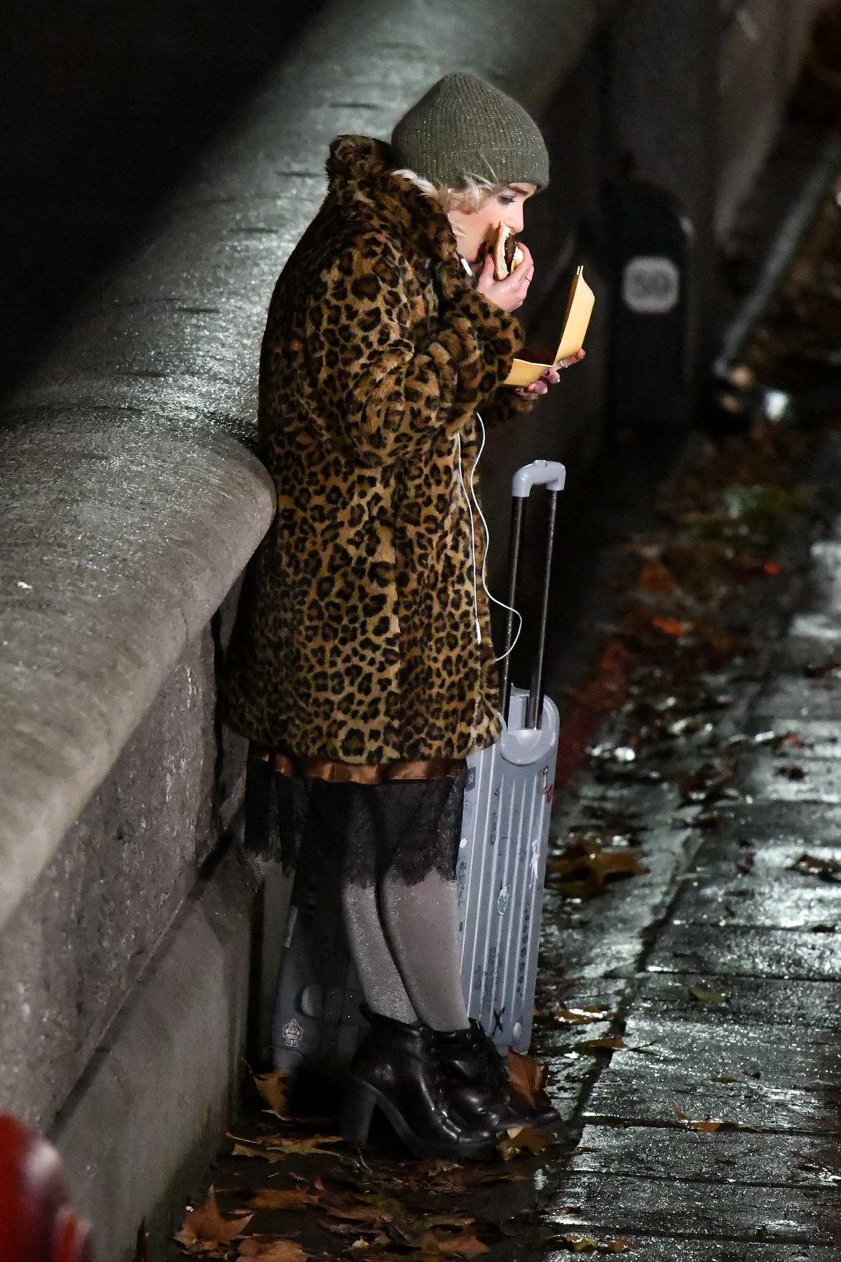 Emilia Clarke spotted in a leopard print fur coat with a suitcase while filming scenes for 'Last Christmas' in London, UK