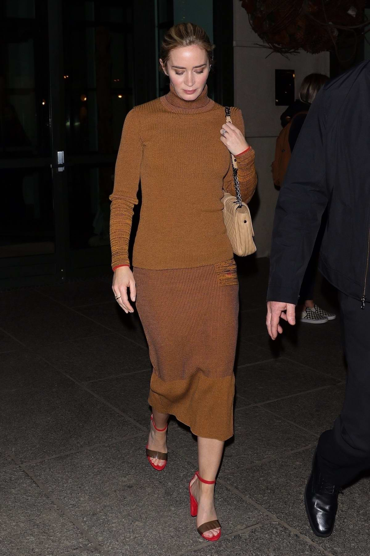 Emily Blunt spotted in a brown dress as she leaves the 'Mary Poppins Returns' screening in New York City