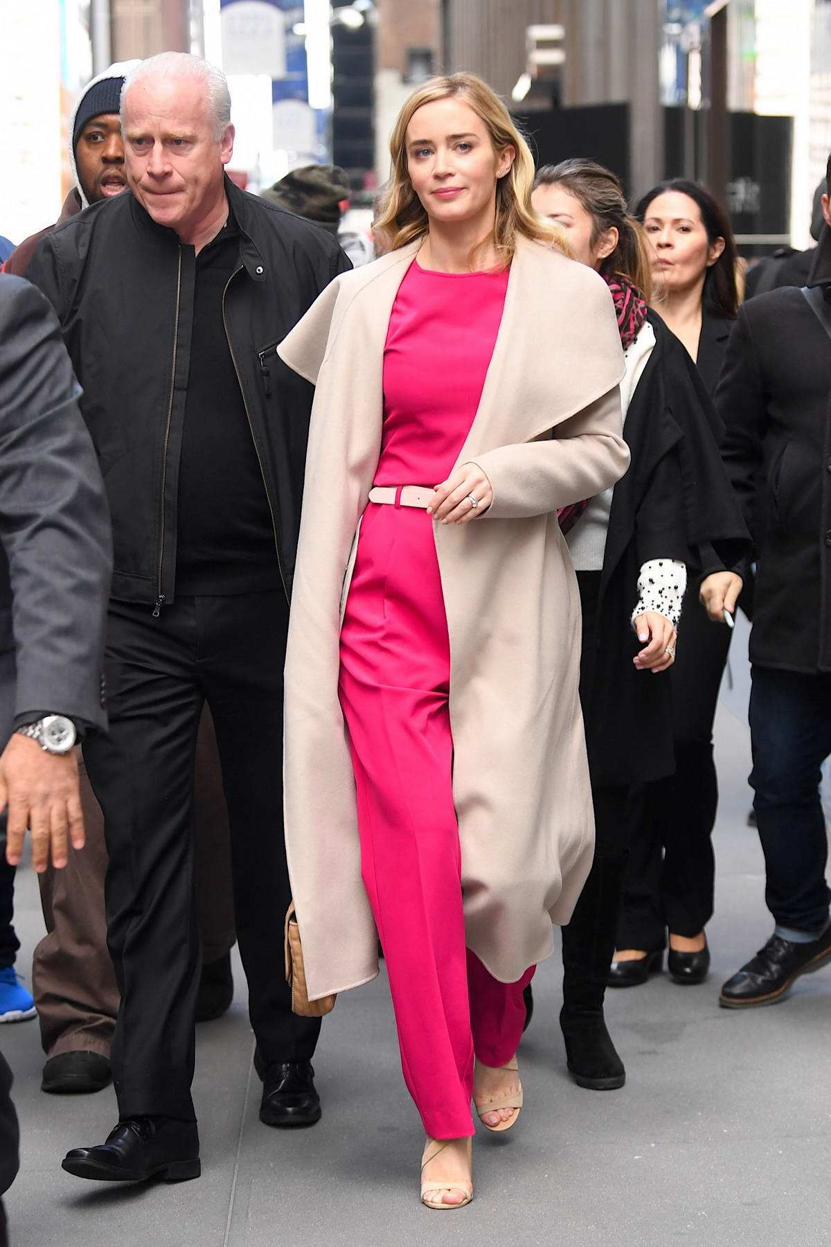 Emily Blunt wore a pink outfit with a beige trench coat while visiting SiriusXM Radio Studios in New York City