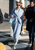 Gigi Hadid keeps it stylish with a soft blue overcoat as she touches down in Milan, Italy
