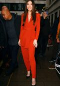 Hailee Steinfeld wears an orange jumpsuit while out promoting her upcoming movie Bumblebee in London, UK