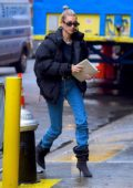 Hailey Baldwin wears a puffer jacket over an 'Off-White' top and jeans as she attends the church service before heading off to airport in New York City