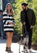 Heidi Klum and boyfriend Tom Kaulitz hold hands as they enjoy a walk out with his dog in Los Angeles
