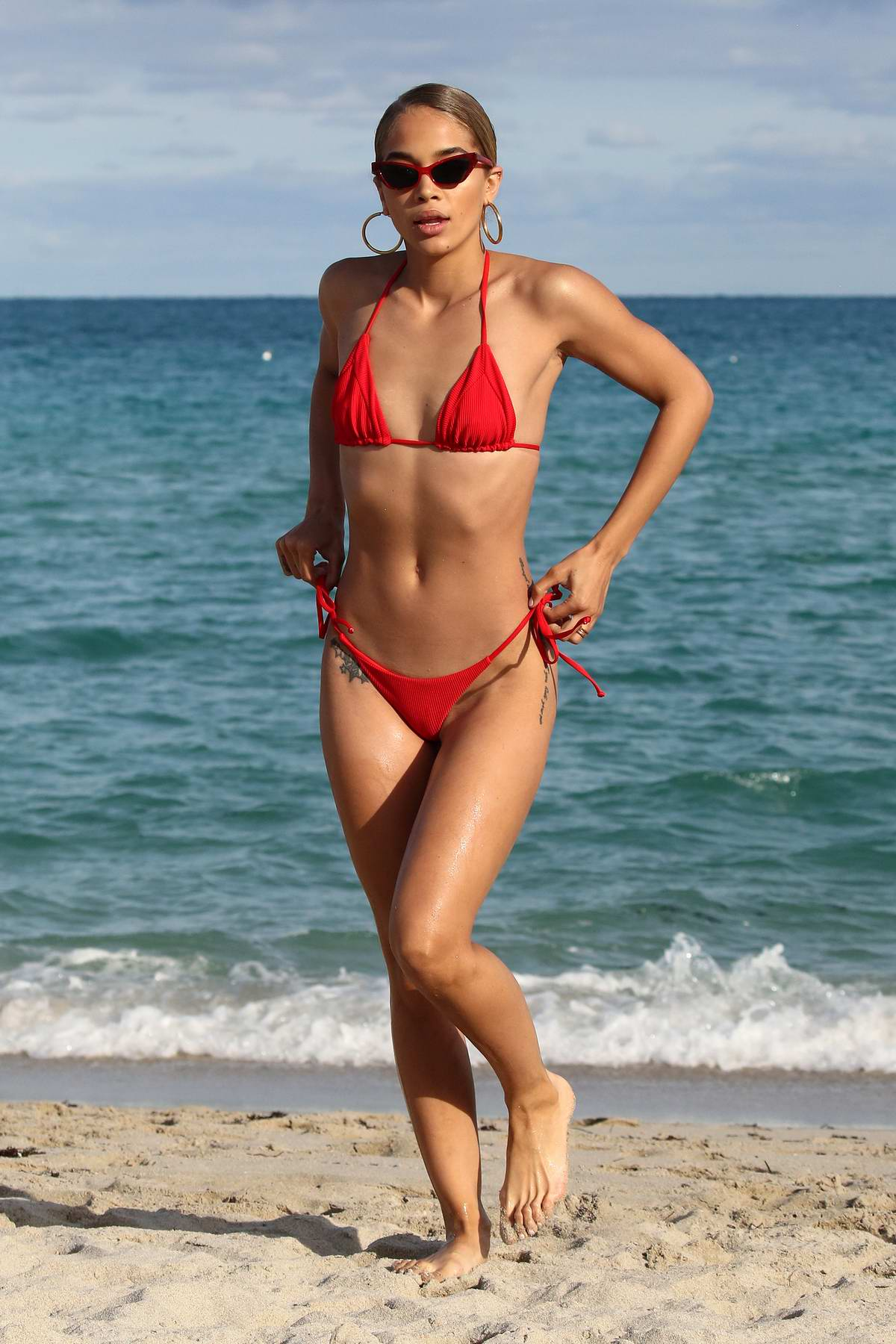 Jasmine Sanders wears a red bikini as she hits the beach in Miami, Florida