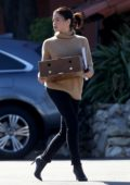 Jenna Dewan steps out in a brown turtleneck, skinny jeans and high heeled boots as she run errands while holding a box in Los Angeles