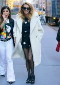 Julia Roberts is all smiles as she steps out in white fuzzy coat in New York City
